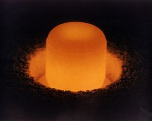 A glowing cylinder of 238PuO2